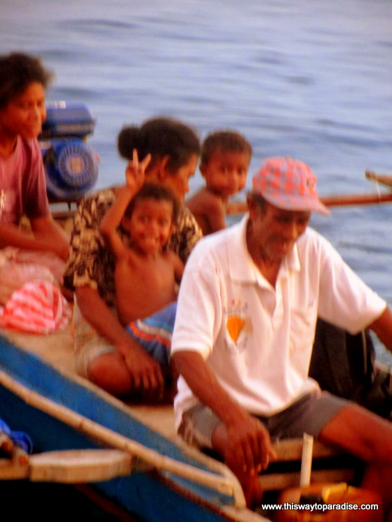 Local family on boat, Raja Ampat