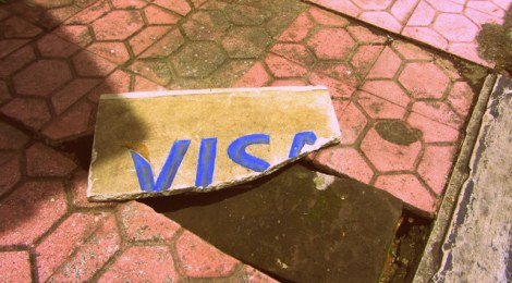 Broken Visa sign consumerism in America