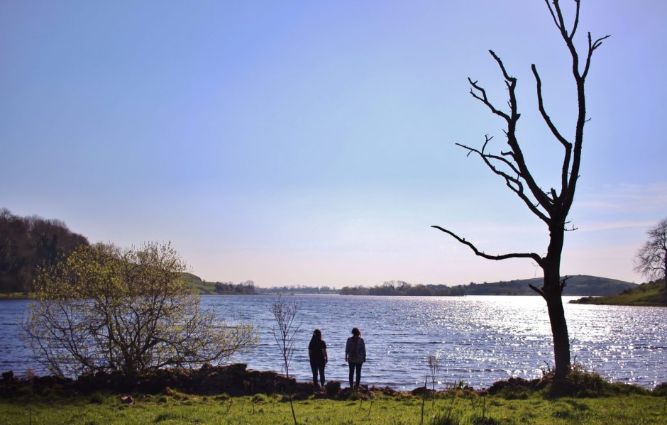 Standing on the shores of Lough Gur, Ireland