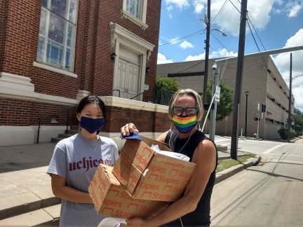 Way Home staff passing out masks to the community.