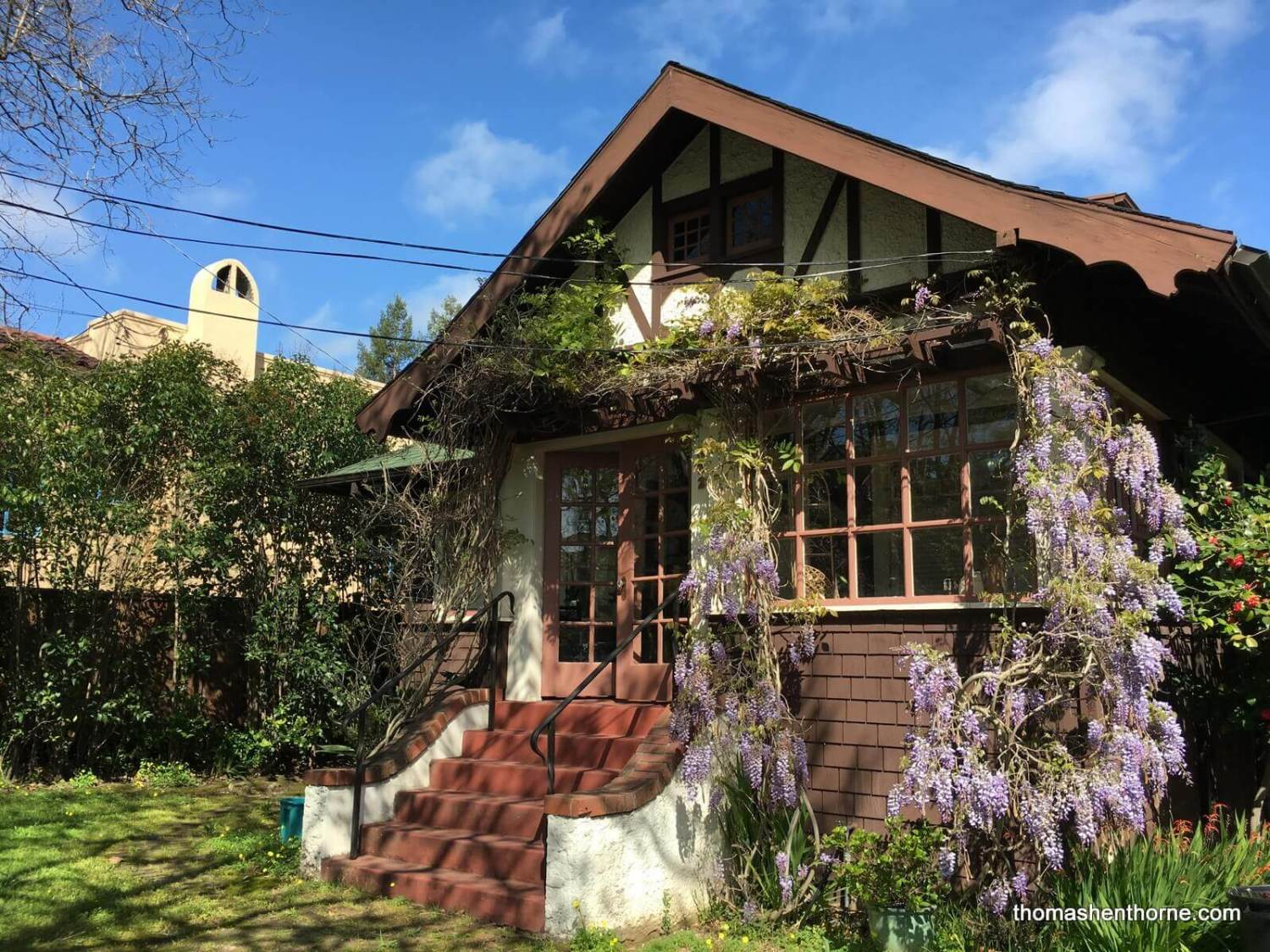 photo of gerstle park bungalow with wysteria in bloom