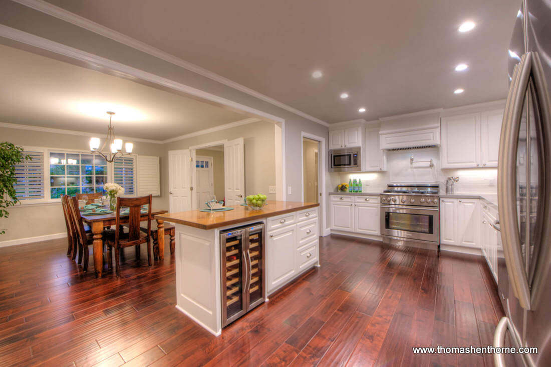 Open Kitchen With Wine Cooler and Stainless Appliances