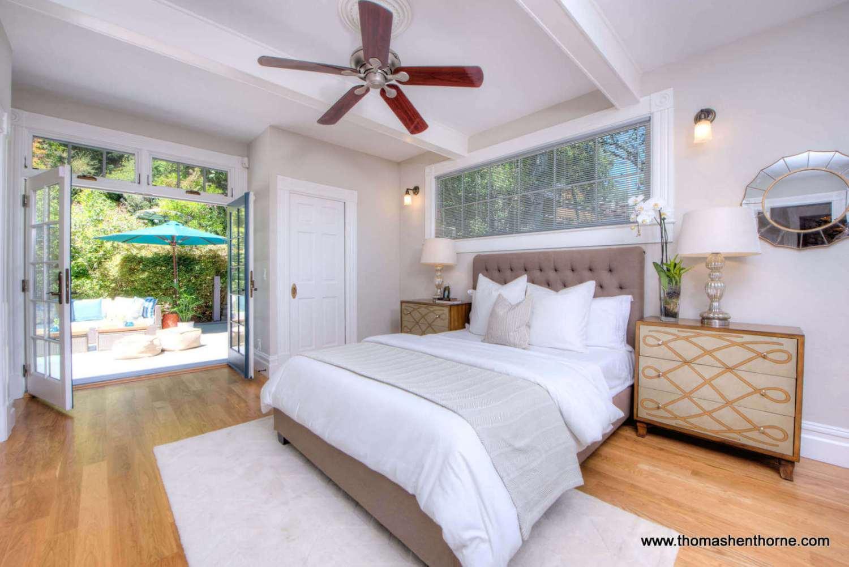 photo of master bedroom opening onto outdoor deck