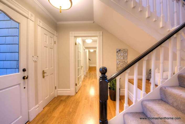 Entry stairway with hardwood floors