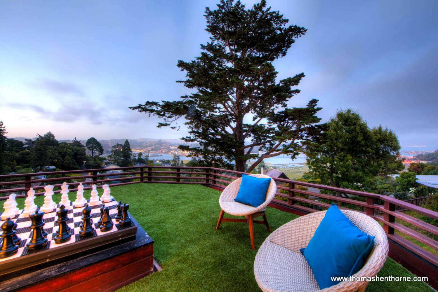 Deck with two chairs and big chessboard
