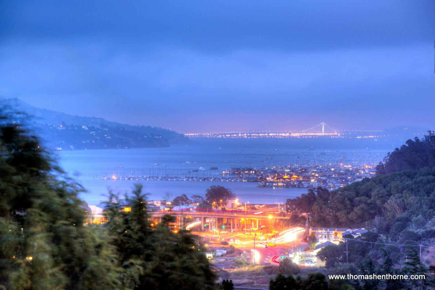 Night time view of bay and bay bridge from home