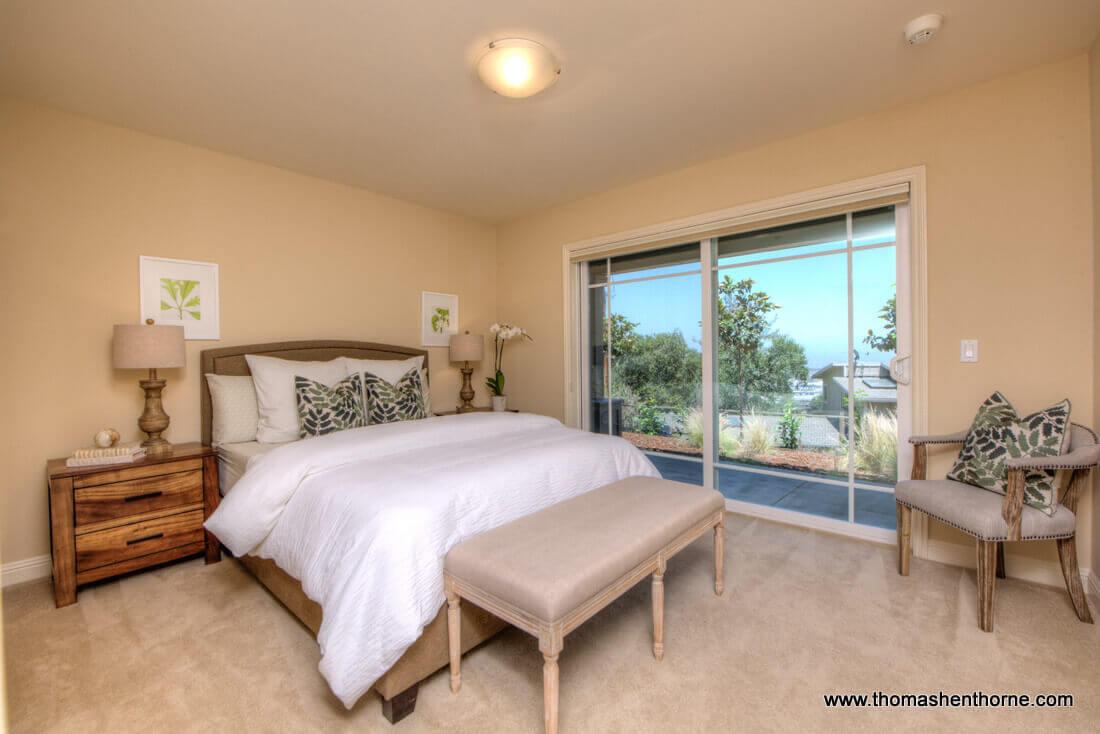 Photo of bedroom #2 with sliding door to exterior yard