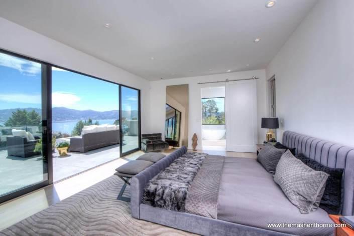 master bedroom with door open to terrace