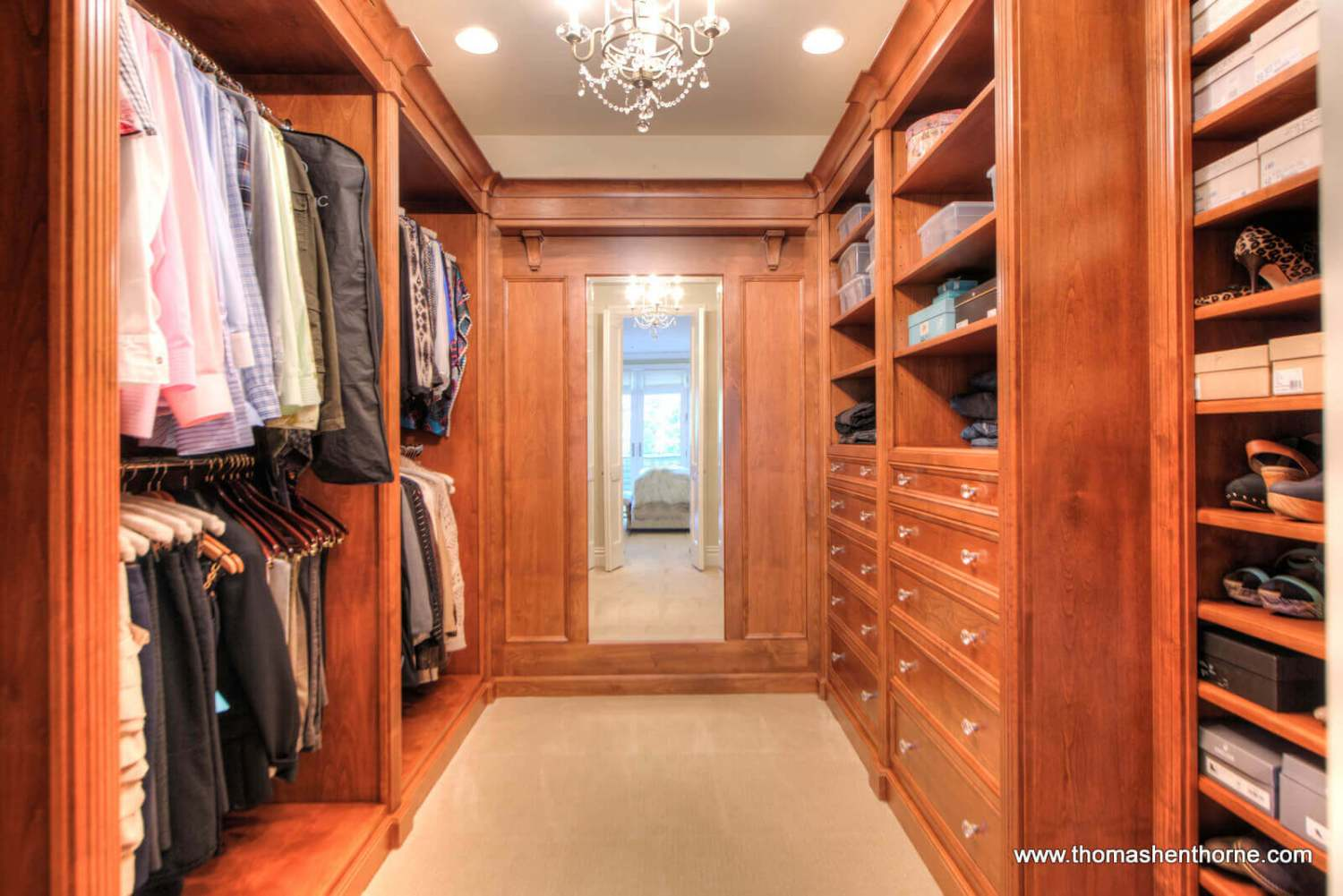 master closet with shelves and mirror and chandelier