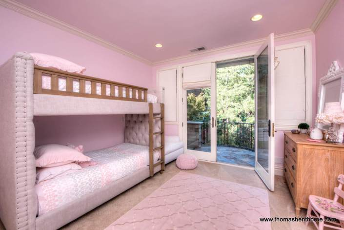 pink bedroom with bunk beds