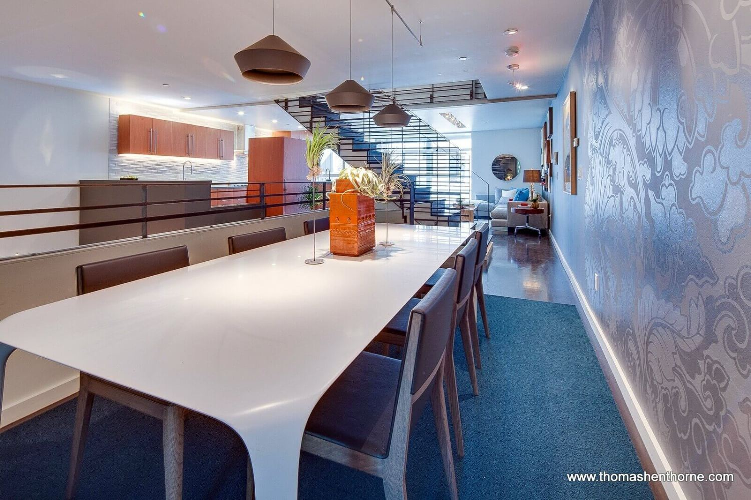 Dining area with view of kitchen and second living room