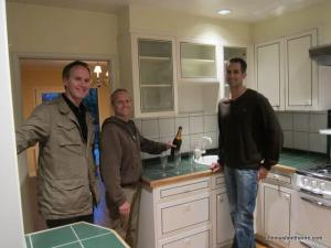 Jim Tyson and Michael Perona with Thomas Henthorne in the dated kitchen of their just-purchased home.