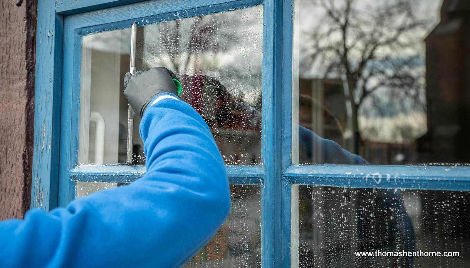 photo of window being cleaned for Marin County Spring Home To Do List