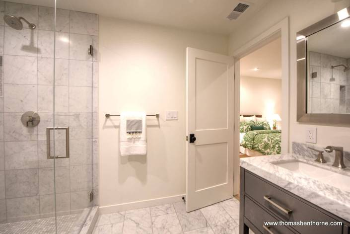Master bathroom with marble vanities, floor and shower