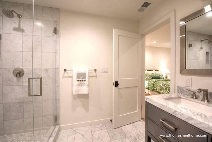 Master bathroom with marble vanities, floor and shower