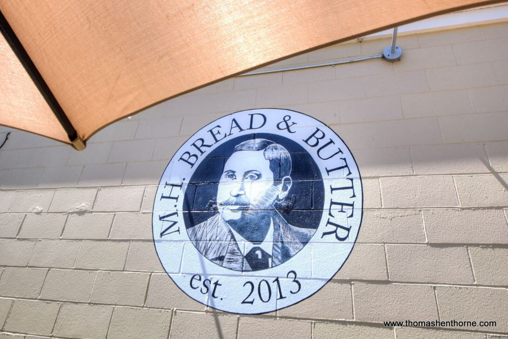 logo painted on wall of M.H. Bread & Butter in San Anselmo, California
