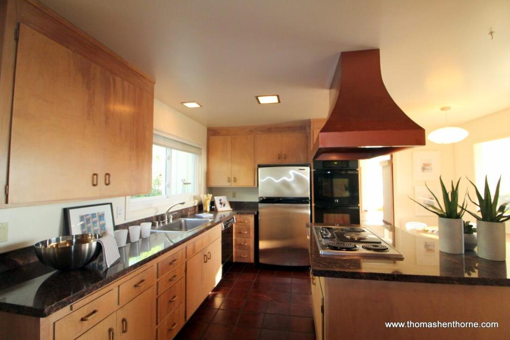 View of kitchen with copper colored hood