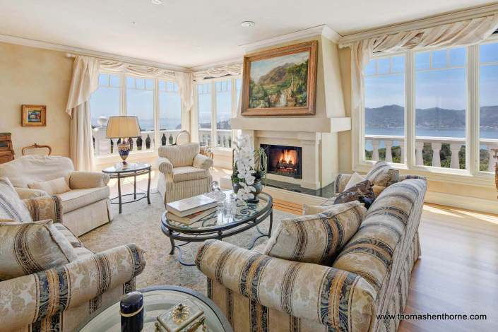 Living room with fireplace and stunning view