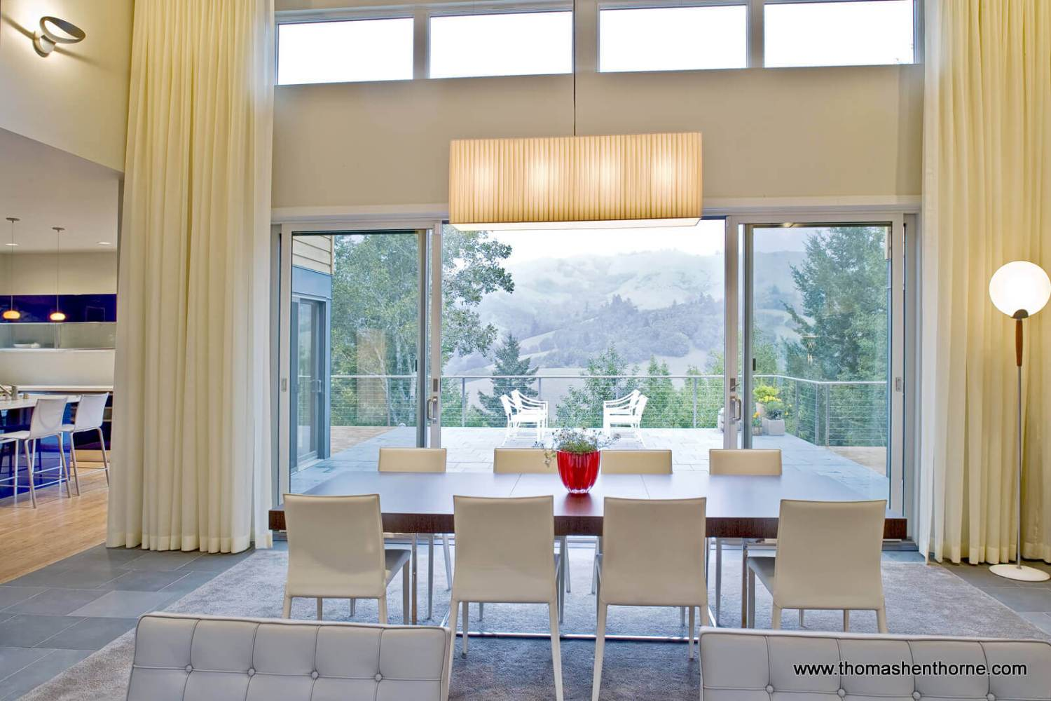 Dining area opens onto patio with gorgeous view