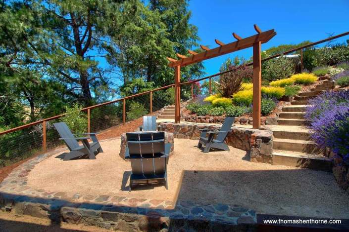 Fire pit with garden and stairs and trellis