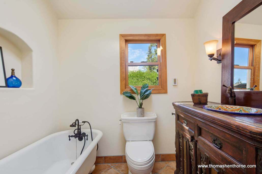 Bathroom with antique tub and toilet and vessel sink