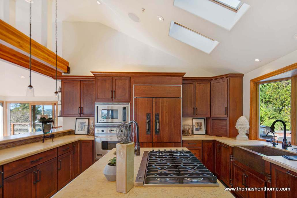 Kitchen with skylights and gas cook top in center island
