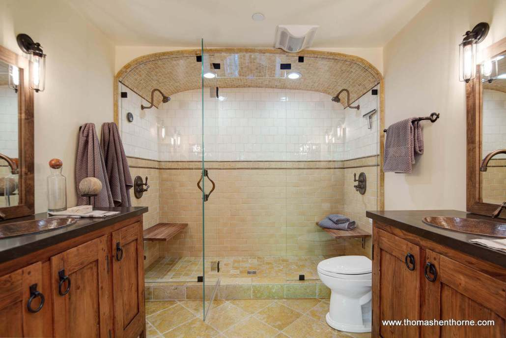 Bathroom with dual sinks and shower heads