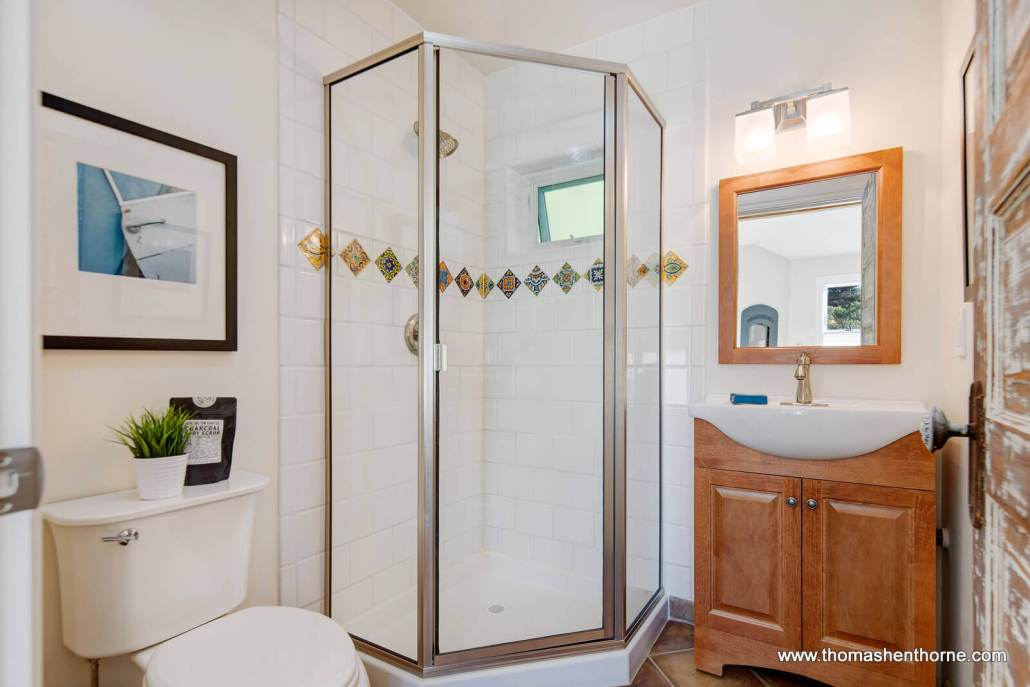 bathroom with glass shower enclosure