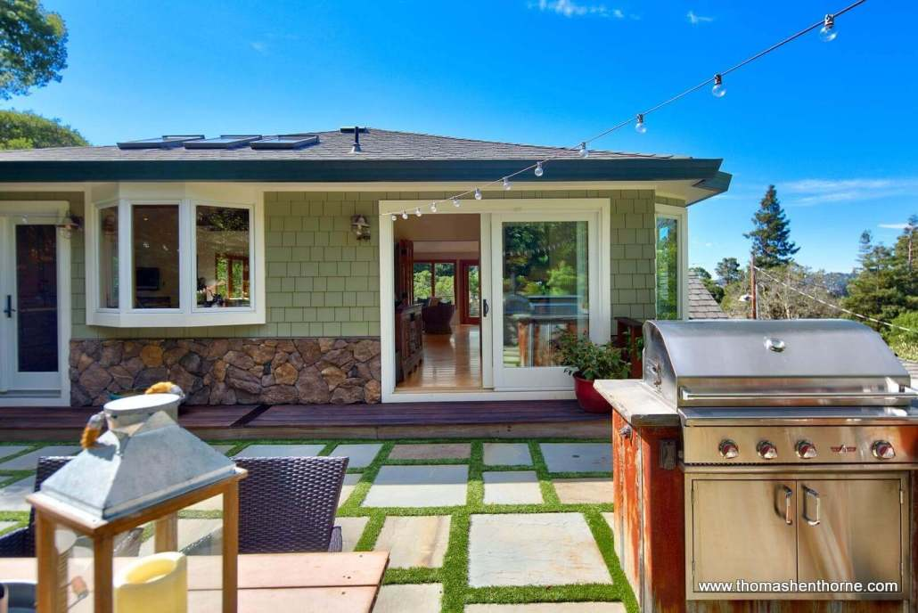 BBQ grill and shingled home
