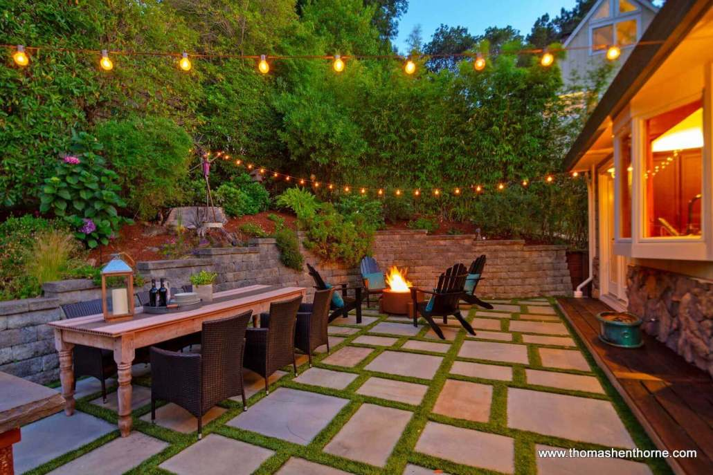 patio with fire pit and dining table