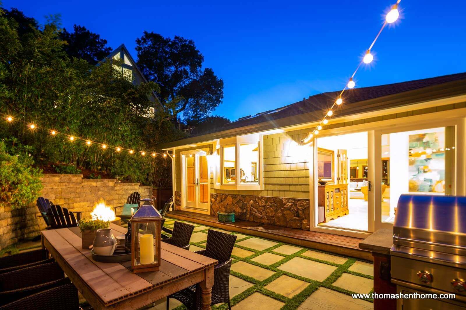 Back patio with string lights at twilight