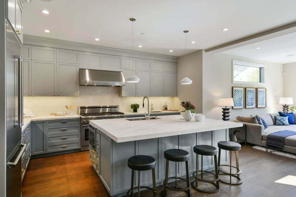 Modern luxury kitchen with large center island and stainless appliances