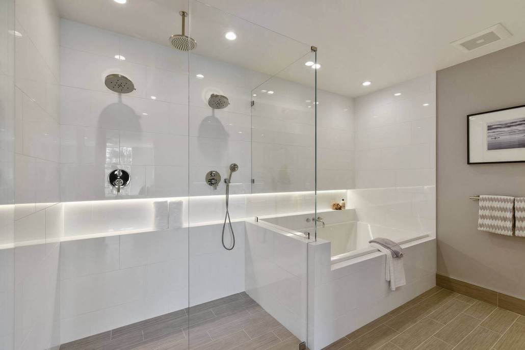 Luxury bathroom with dual shower heads and soaking tub