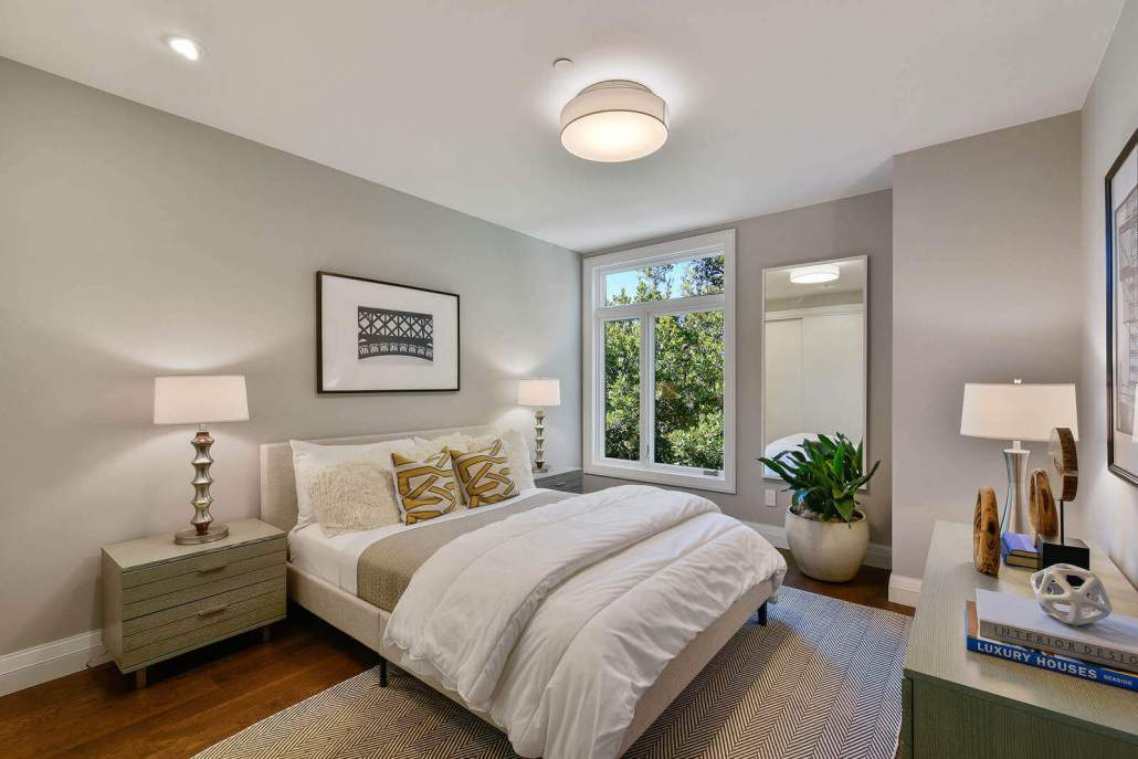 Modern bedroom with bed and window to exterior