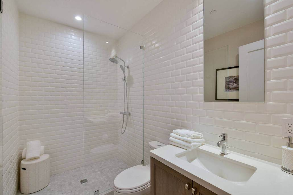 Modern bathroom with custom tile work and glass shower enclosure