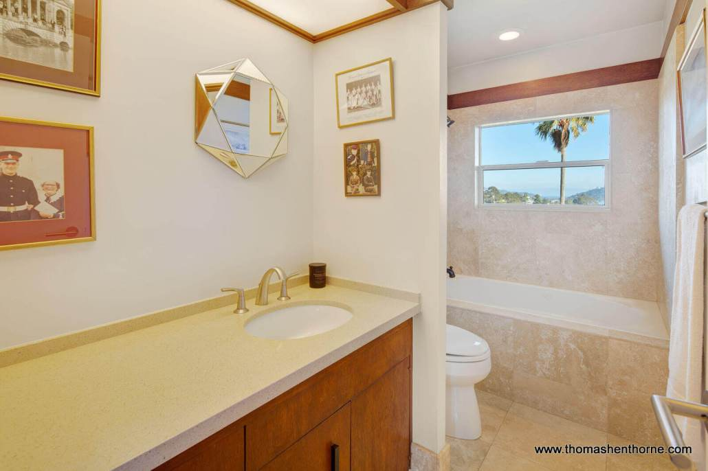 Bathroom with large vanity and soaking tub