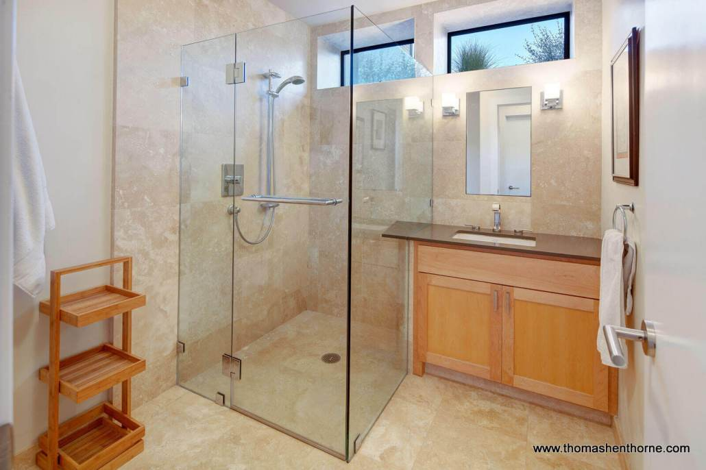 Bathroom with large glass enclosed shower and single vanity
