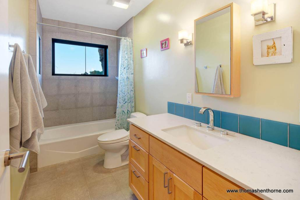 Bathroom with sink and shower tub combo