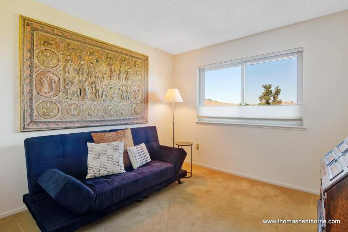 Bedroom with purple sofa
