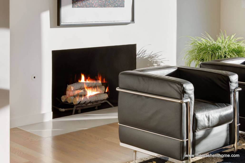 Modern fireplace and black leather chair