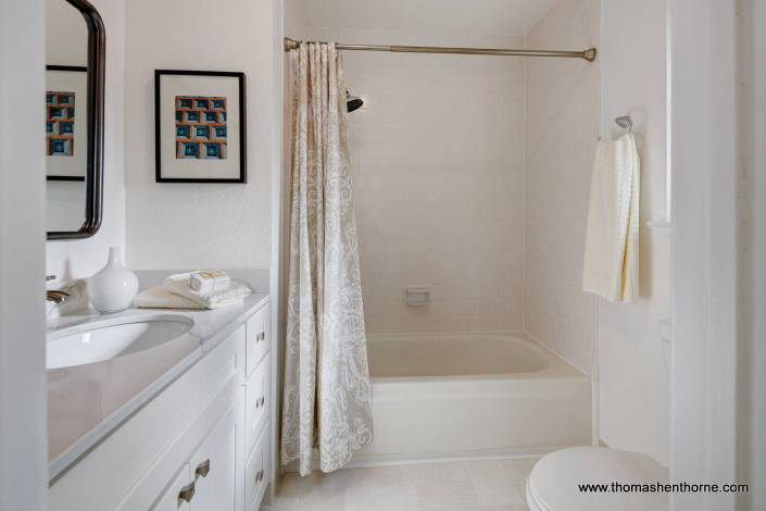 Bathroom with toilet and full shower bath