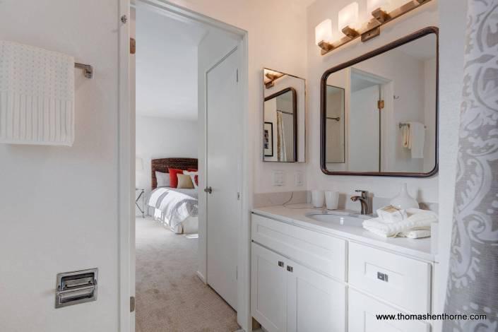 Bathroom with door open to bedroom