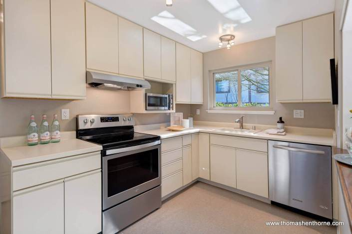 kitchen with stainless appliances and light colored cabinetry