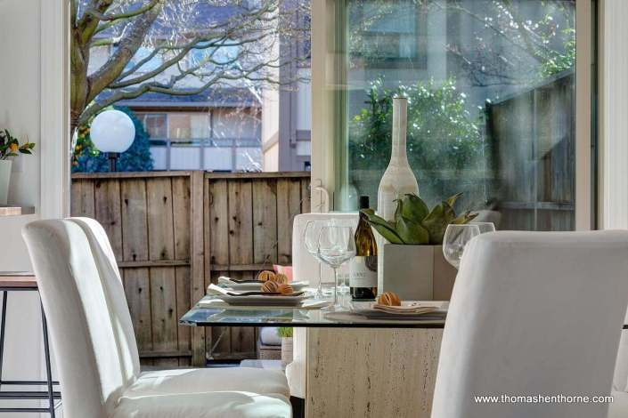 Dining table with open patio doors