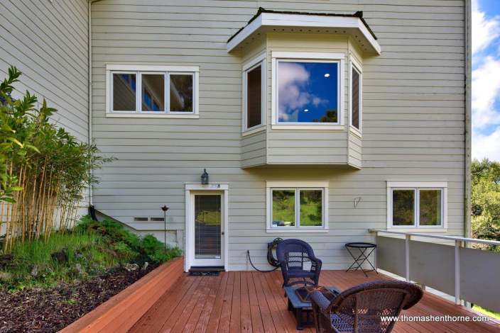 Deck with door and bay window above