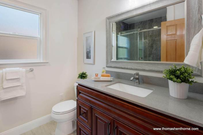 Bathroom with toilet and quartz counters