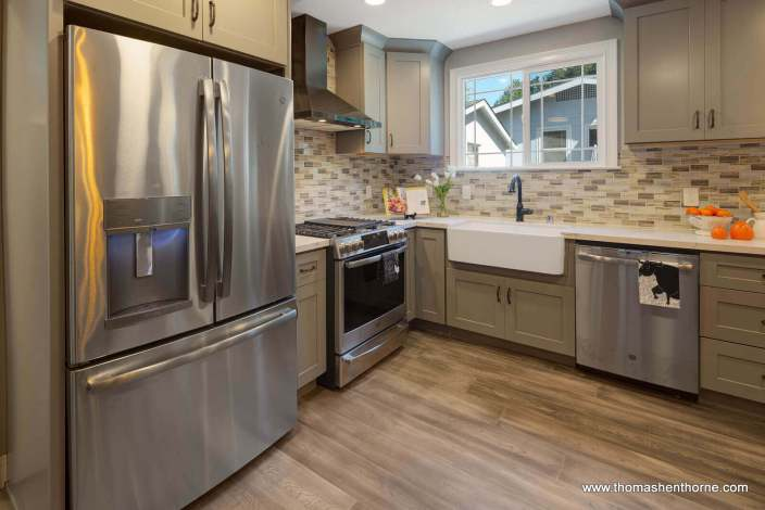 Modern kitchen with stainless appliances and one window