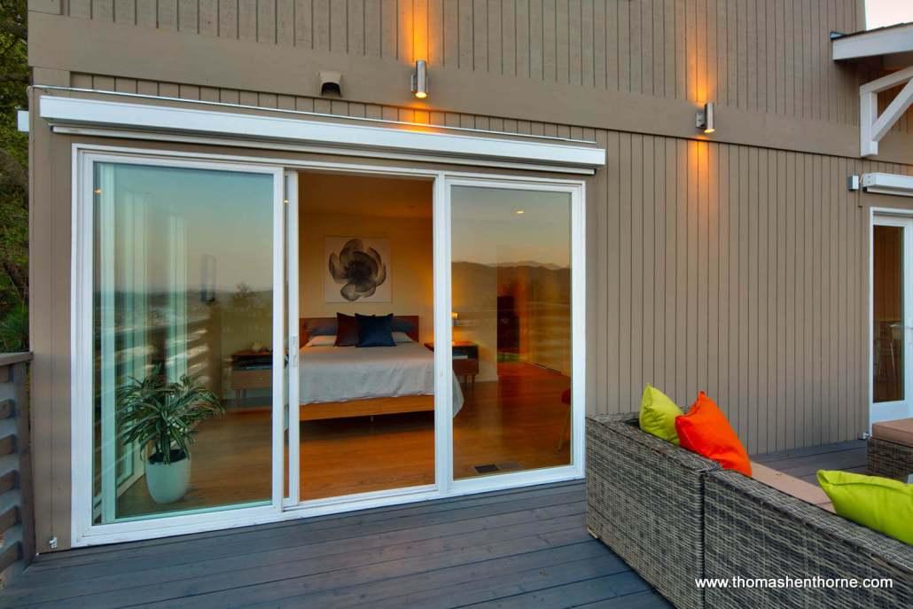 Bedroom through sliding doors from deck