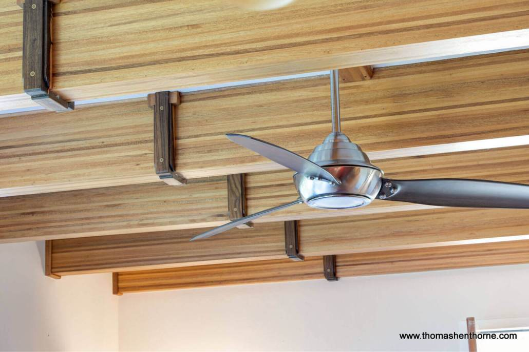Modern ceiling fan and wood ceiling beams