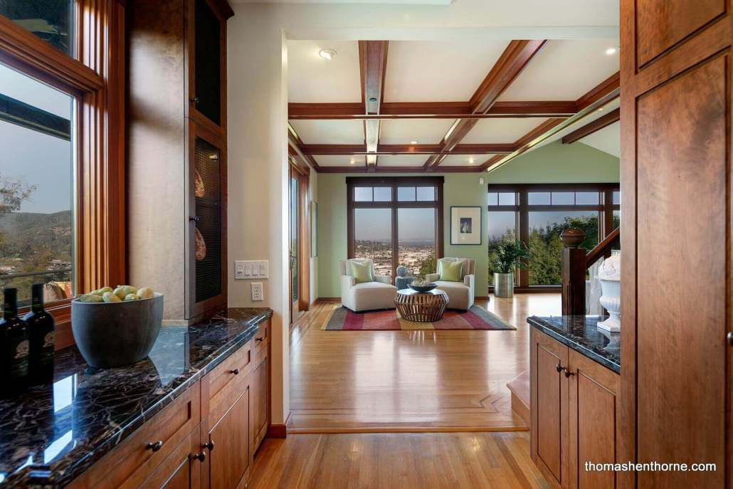 Room with hardwood floors and coffered ceilings